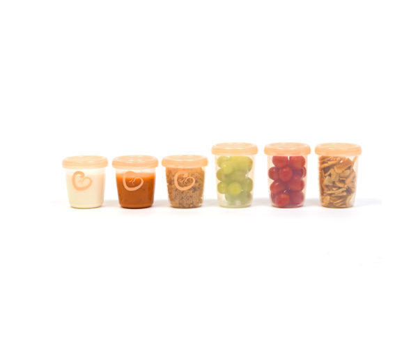 Eonian Care storage containers holding food with orange lid